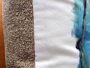 Beautifully soft sand pebble fabric is hand-sewn to the back of each pillow